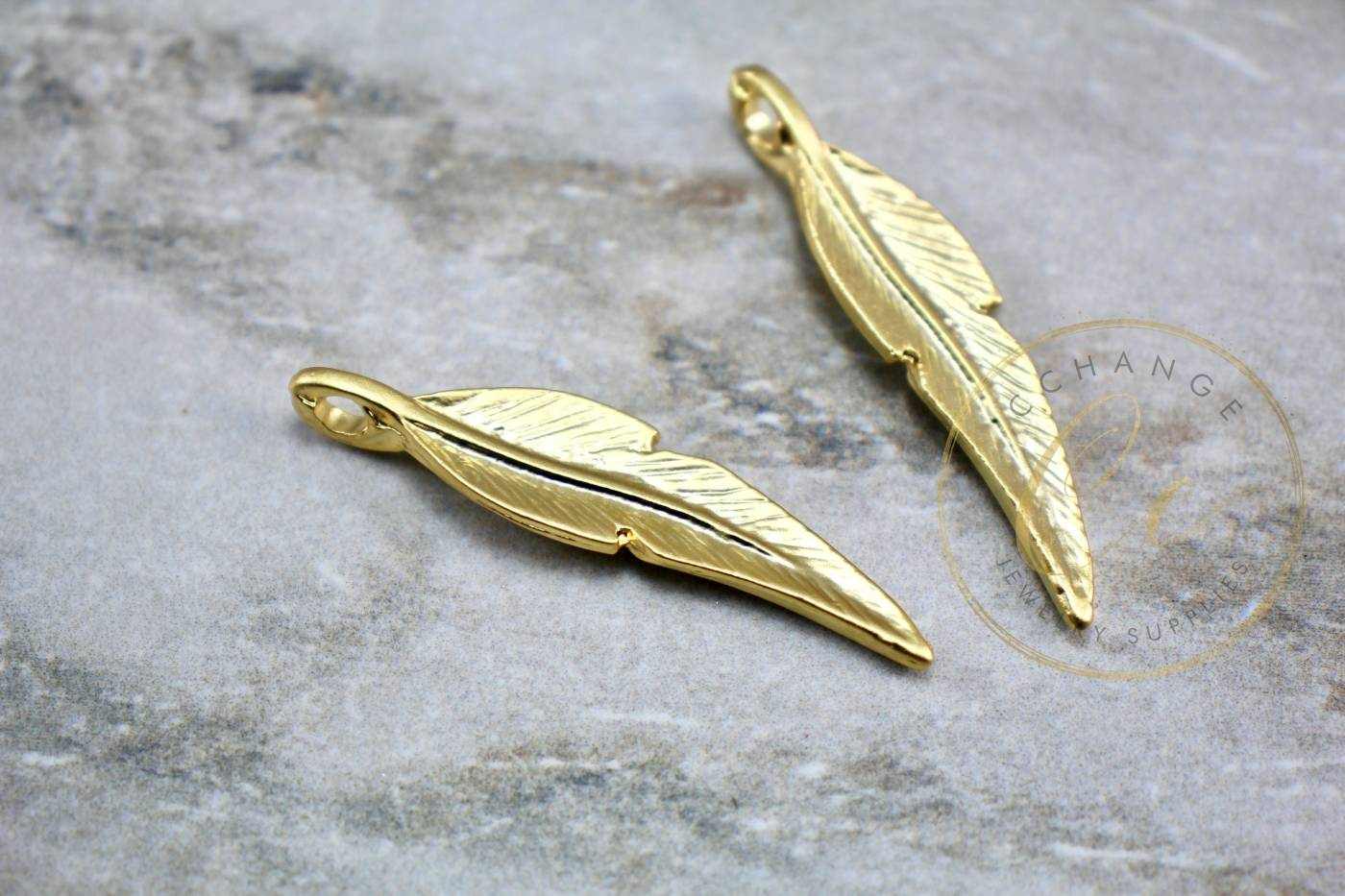 gold-plate-metal-jewelry-feather-pendant.jpg