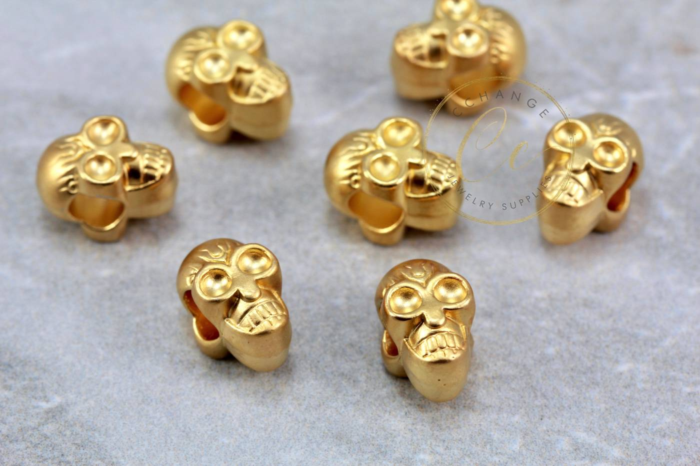 gold-plated-metal-skull-bead-charms.jpg