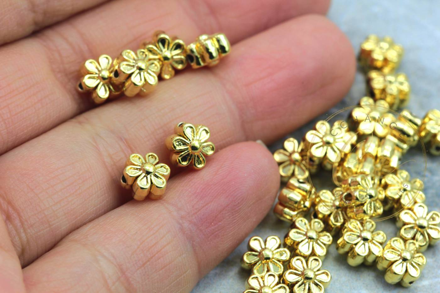 gold-plated-metal-mini-flower-charms.jpg