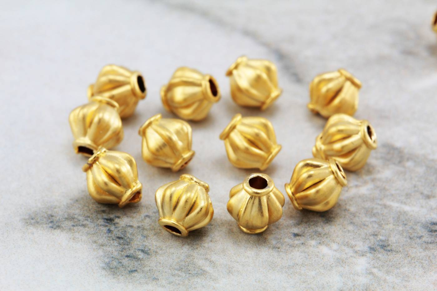 gold-plated-6mm-round-shape-spacer-beads.jpg