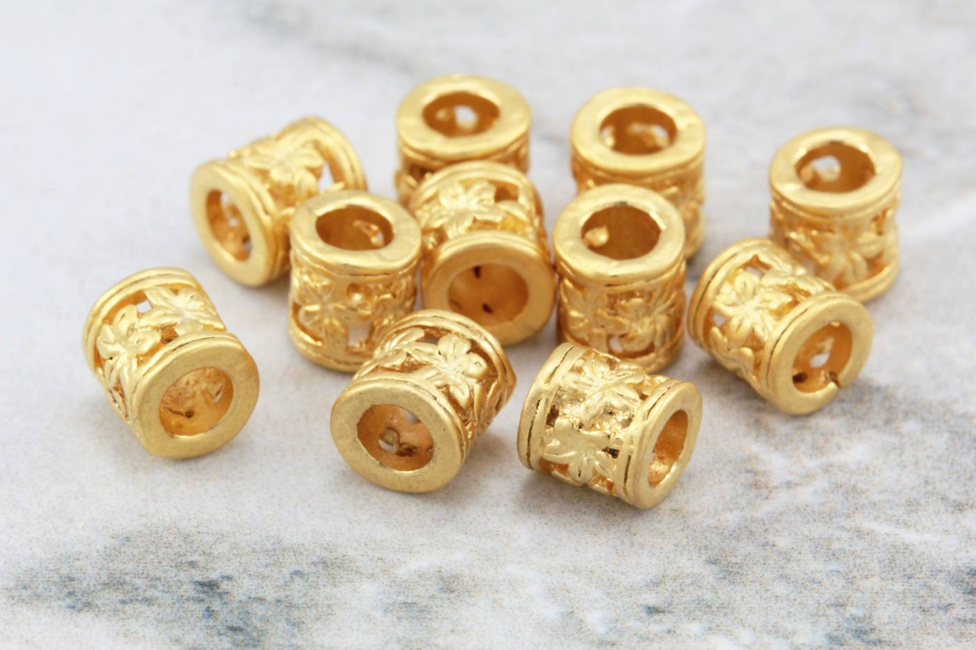 6mm-gold-tube-beads-with-flower-pattern.jpg