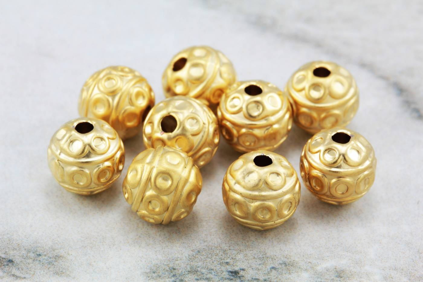 gold-metal-tribal-round-ball-beads.jpg