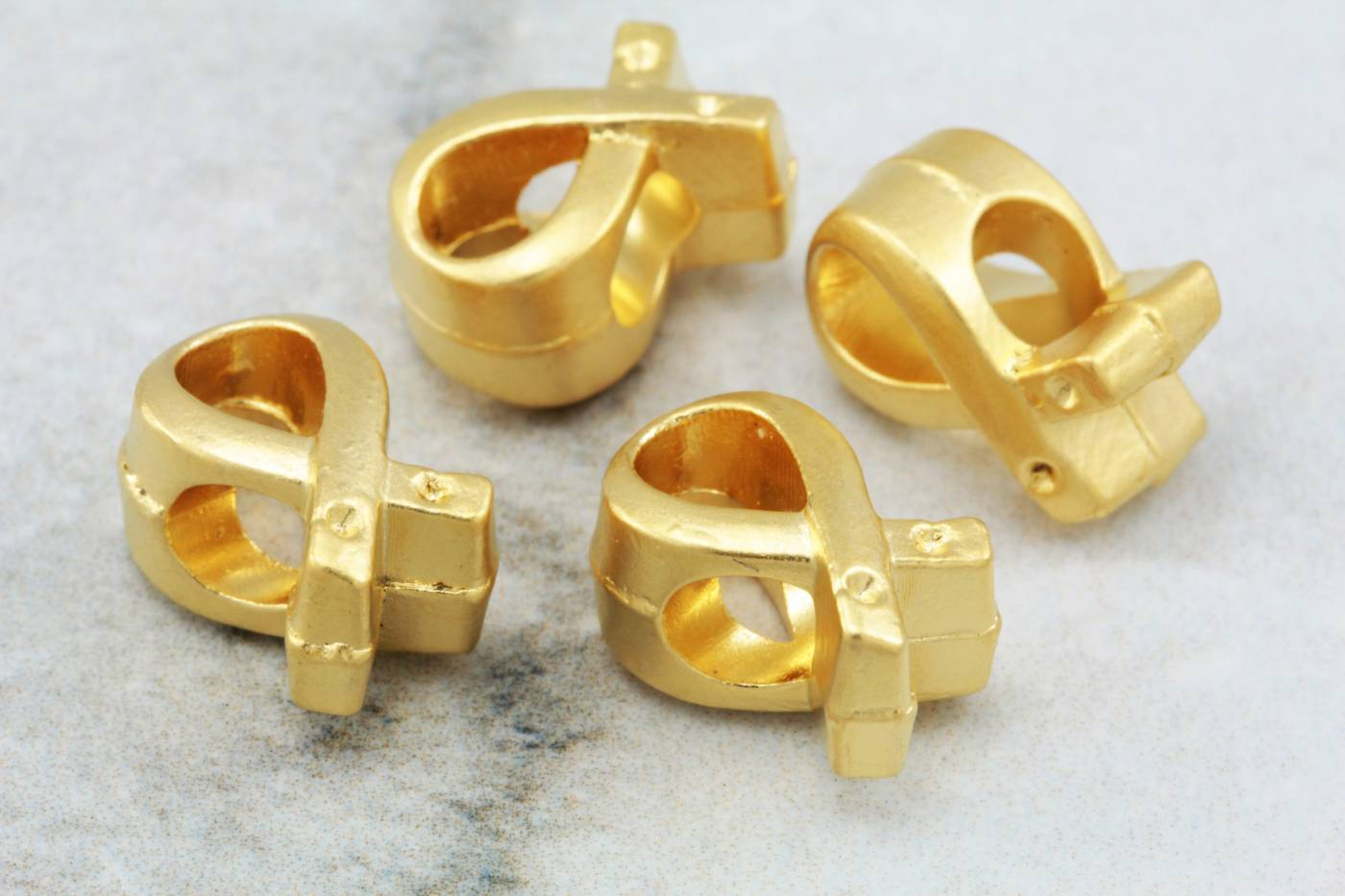 matte-gold-plated-metal-bow-charm-supply.jpg