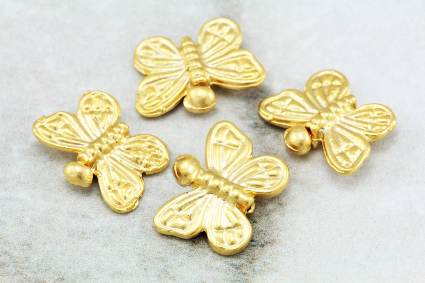 matte-gold-plated-metal-butterfly-charms.jpg
