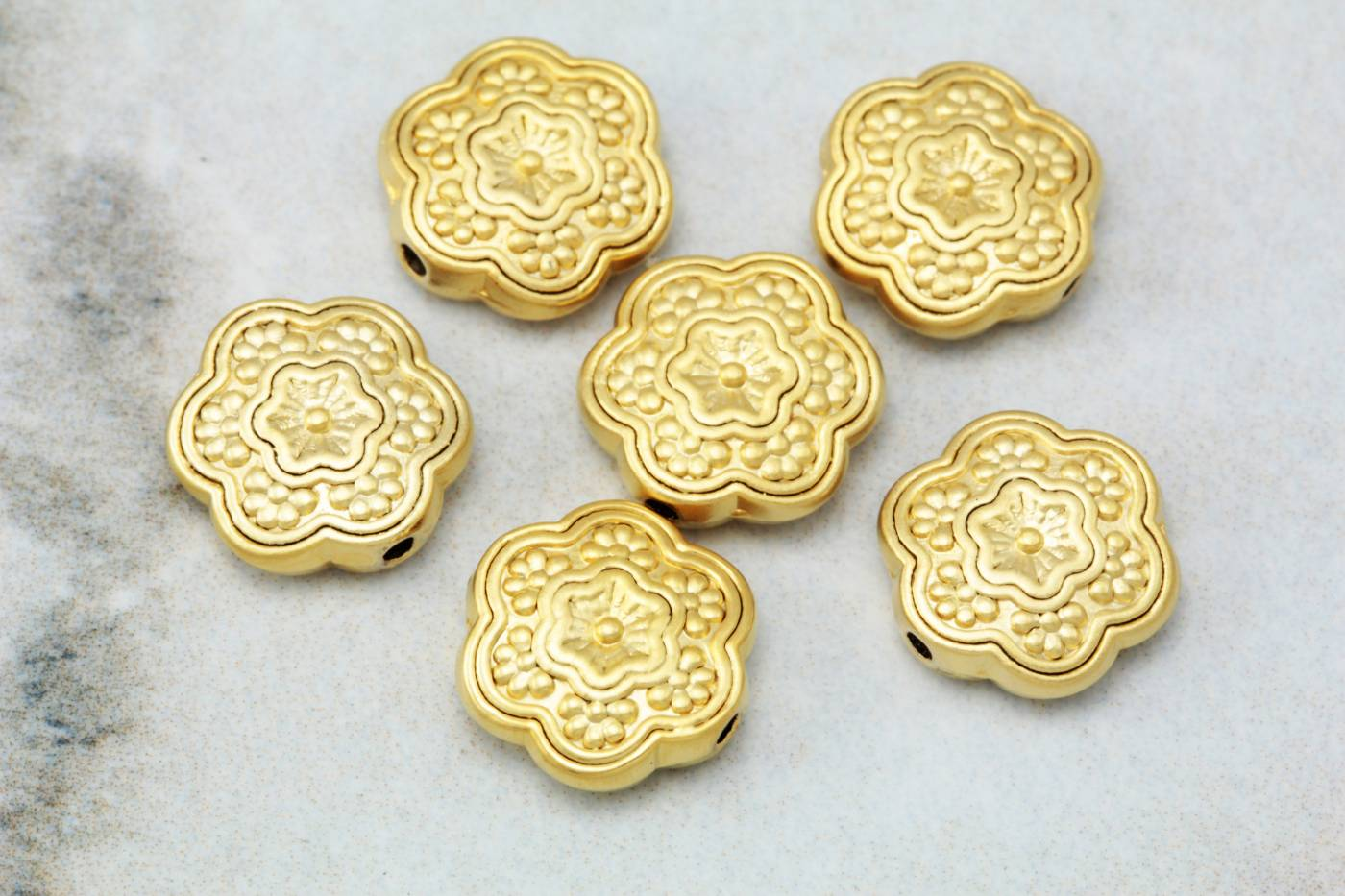 gold-plated-metal-flat-daisy-charms.jpg