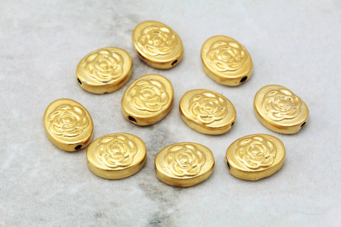 gold-plated-oval-rose-patterned-charms.jpg