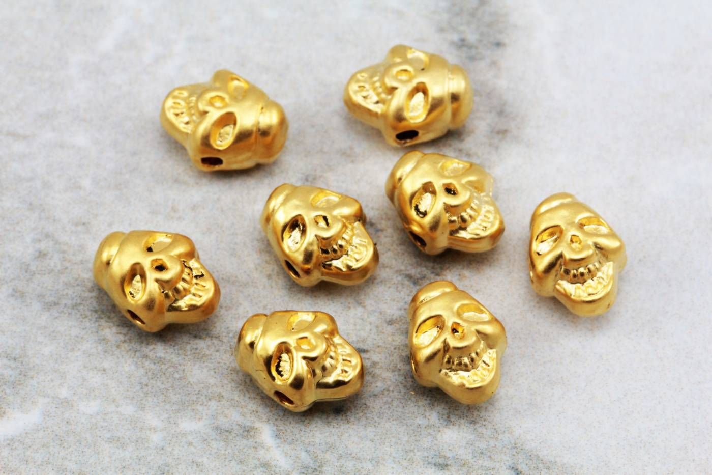 gold-plated-metal-skull-head-charms.jpg
