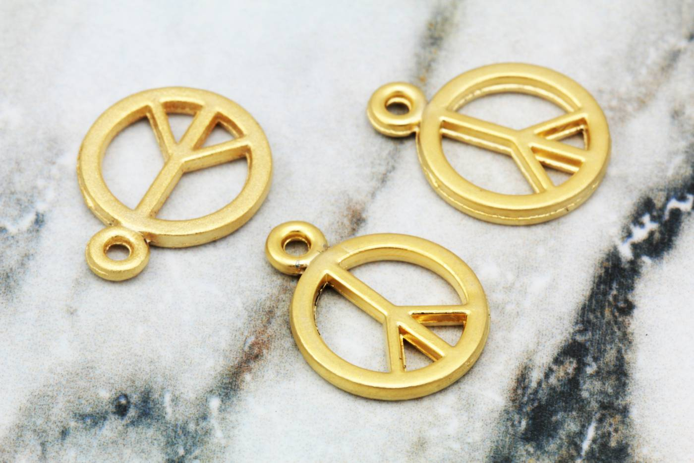 gold-plated-peace-sign-metal-pendants.jpg