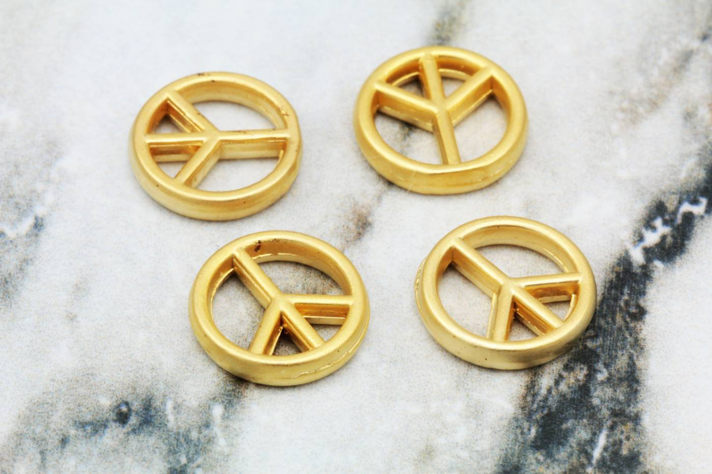 gold-metal-bohem-peace-sign-charms.jpg
