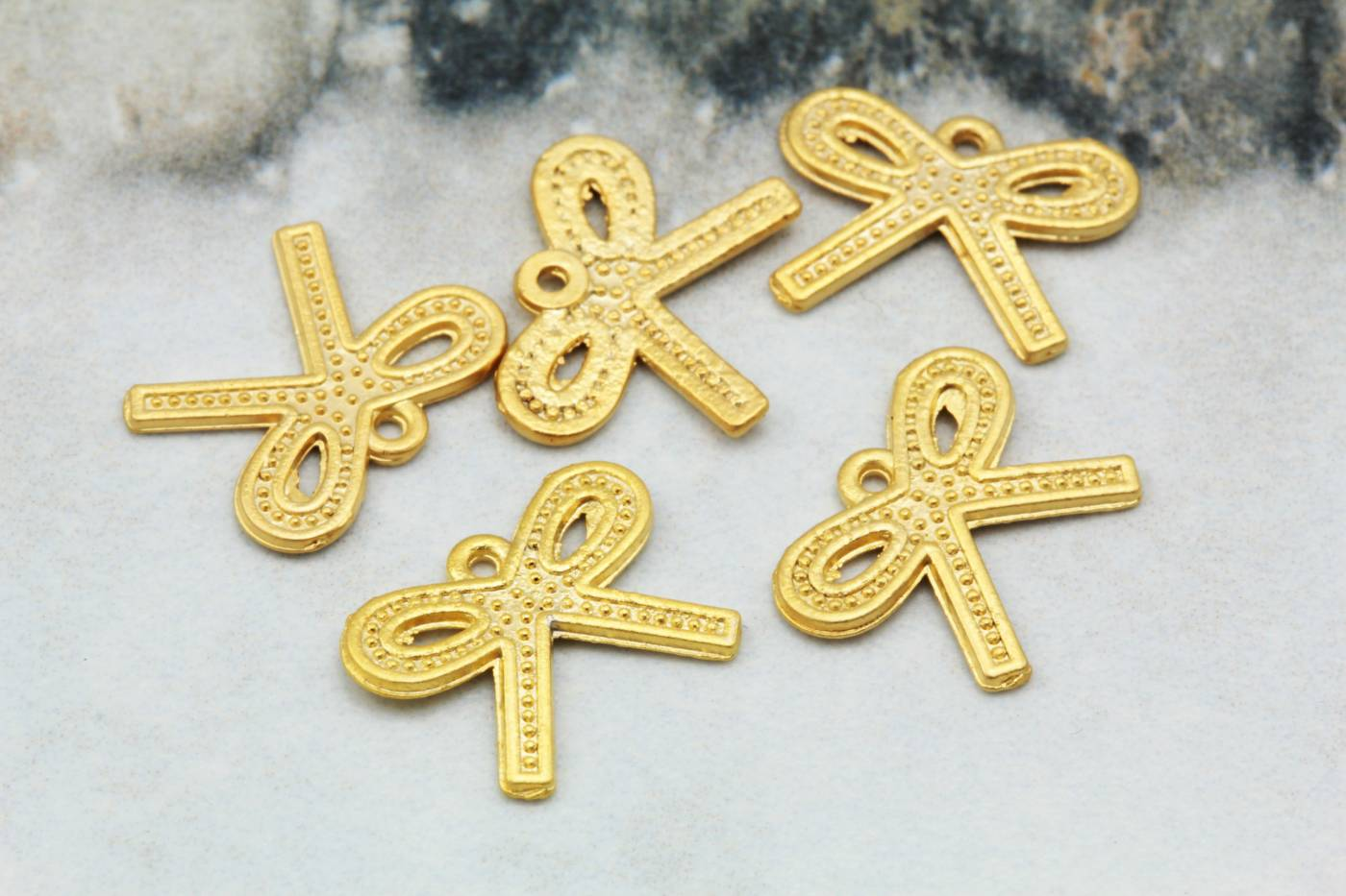 gold-plated-tiny-metal-bow-pendant-charm.jpg