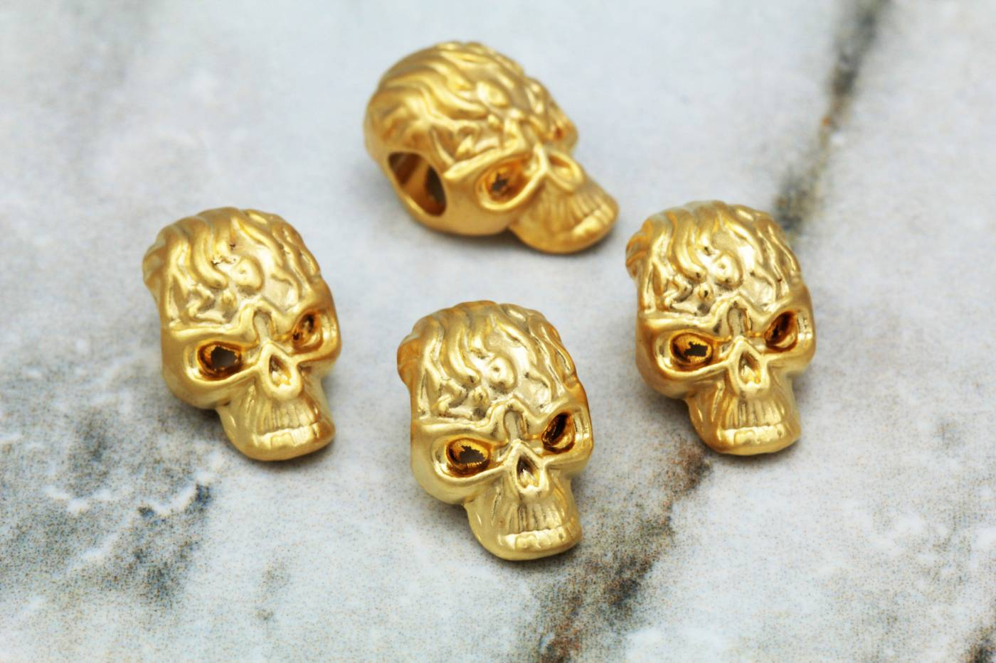gold-plate-metal-skull-jewelry-charms.jpg