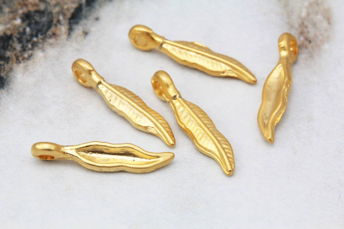 tiny-gold-plated-feather-jewelry-pendant.jpg