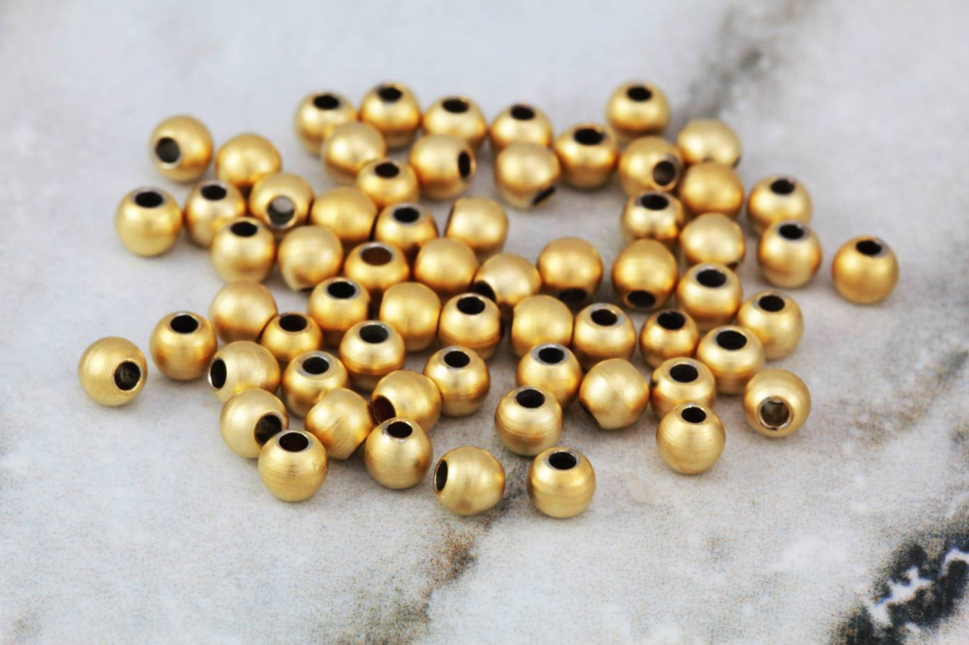 3mm-gold-plated-mini-ball-spacer-bead.jpg