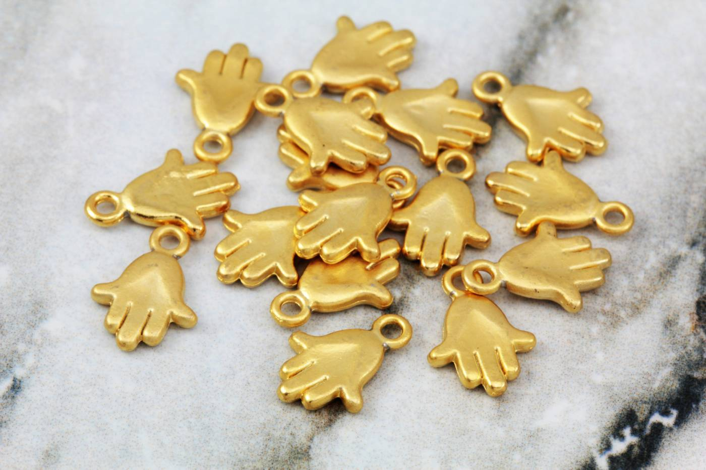 gold-plated-tiny-fatima-hand-pendants.jpg