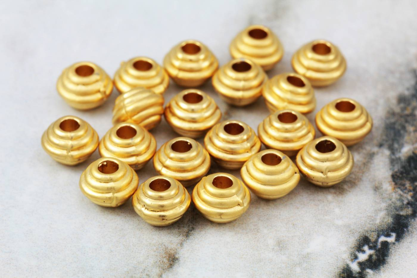gold-mini-saucer-shape-spacer-beads.jpg
