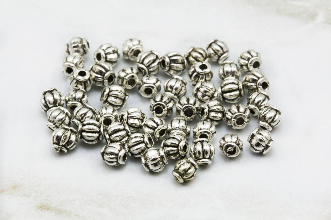 4mm-round-ball-jewelry-spacer-beads.jpg