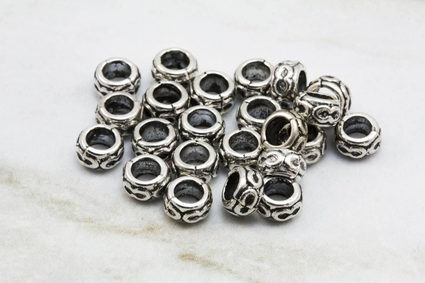 6mm-metal-silver-round-jewelry-spacers.jpg
