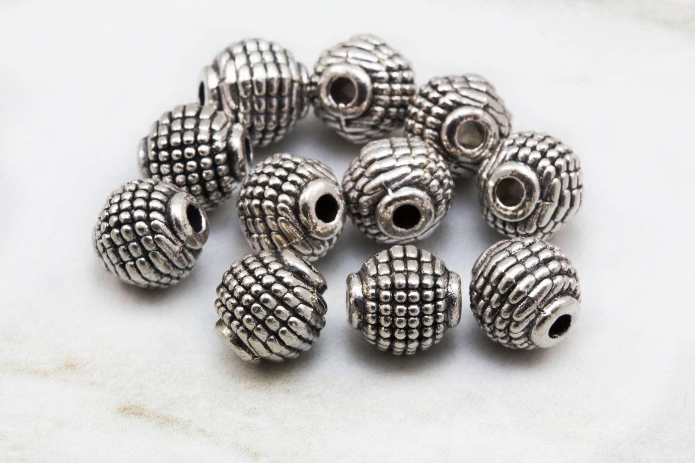metal-round-silver-bead-jewelry-charms.jpg
