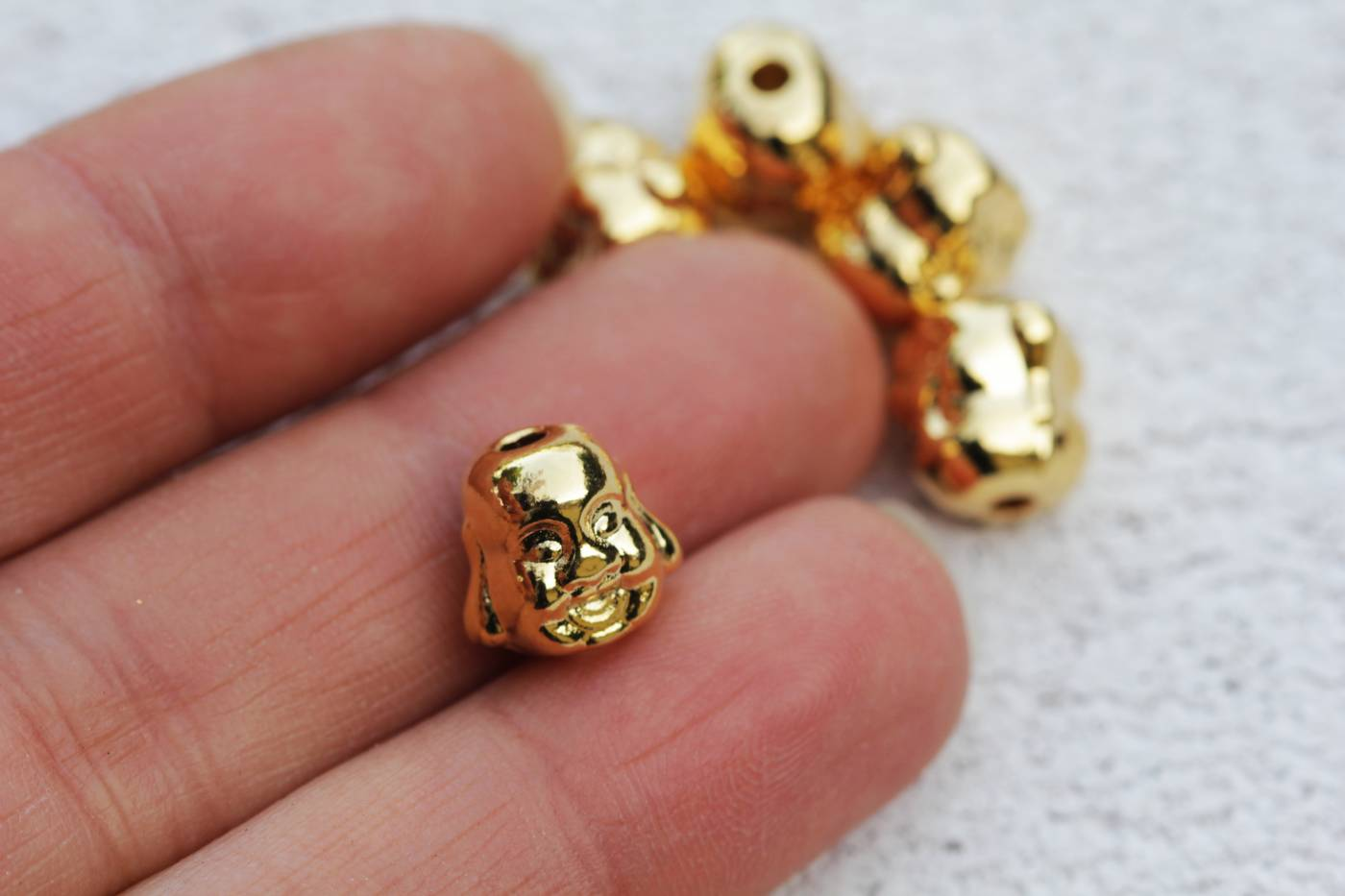 gold-plated-metal-buddha-charm-findings.jpg